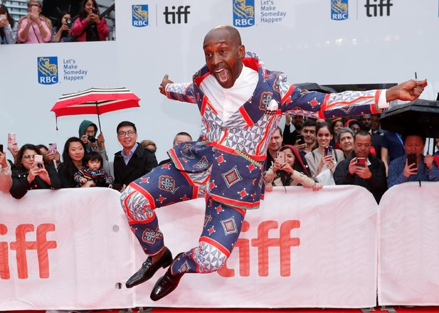 """Rob Morgan takes to the air as he arrives for the Gala Premiere of the film """"Just Mercy"""" at the 2019 Toronto International Film Festival on Friday, Sept. 6, 2019. (Photo by Mario Anzuoni/Reuters)"""