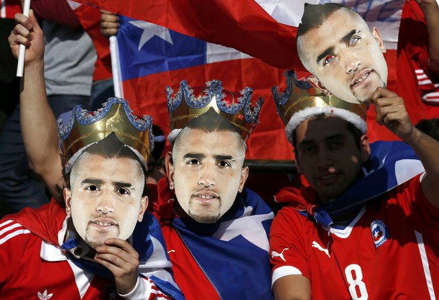 Chilean fans hold masks of Chile's Arturo Vidal before their Copa America 2015 final soccer match against Argentina at the National Stadium in Santiago, Chile, July 4, 2015. (Photo by Henry Romero/Reuters)