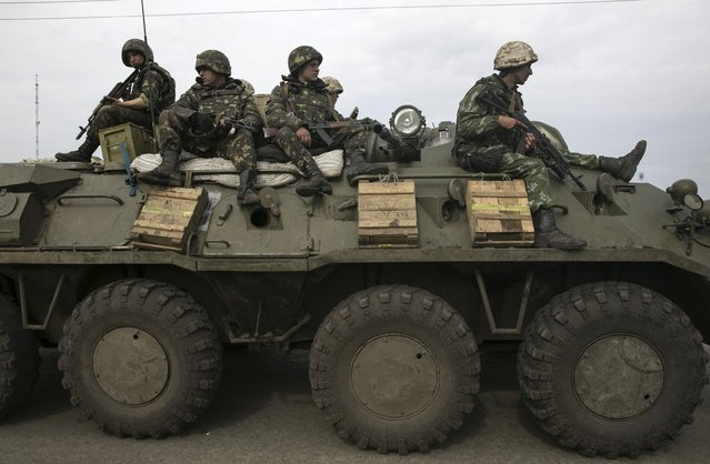 Ukrainian soldiers sit on a armoured personnel carrier at a Ukrainian checkpoint near the eastern town of Slaviansk May 2, 2014. (Photo by Baz Ratner/Reuters)