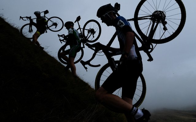 Competitors tackle the brutal climb up Simons Fell as they ascend to the summit of Ingleborough during the 57th Annual Yorkshire 3 Peaks Cyclocross Challenge on September 15, 2019 in Settle, England. The 3 Peaks Cyclocross is staged in the Yorkshire Dales National Park each year. It is renowned as being the toughest and biggest Cyclocross event in the UK. The race was born in 1959 when a Yorkshire schoolboy, Kevin Watson rode, pushed and carried his bicycle 30 miles to the summit cairns of Whernside (2,419ft), Ingleborough (2,373ft) and Penyghent (2,273ft). (Photo by Ian Forsyth/Getty Images)