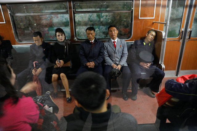 People travel on a train, stopping at a station visited by foreign reporters in Pyongyang, North Korea on April 13, 2017. (Photo by Damir Sagolj/Reuters)