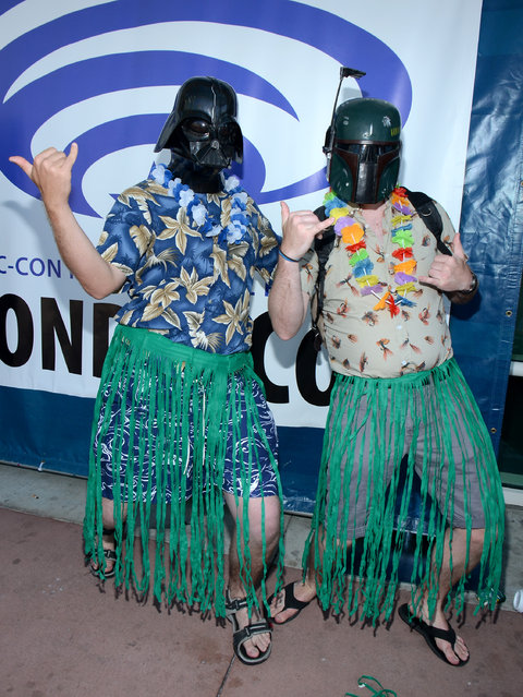 "Fans wearing ""Star Wars"" character masks Darth Vader, left, and Boba Fett attend day 1 of Comic-Con International on Thursday, July 9, 2015, in San Diego, Calif. (Photo by Tonya Wise/Invision/AP Photo)"