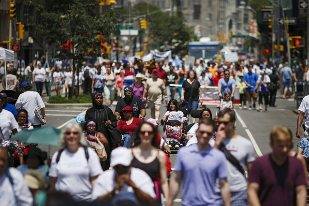 People take part in the disability pride parade in New York, July 12, 2015. (Photo by Eduardo Munoz/Reuters)