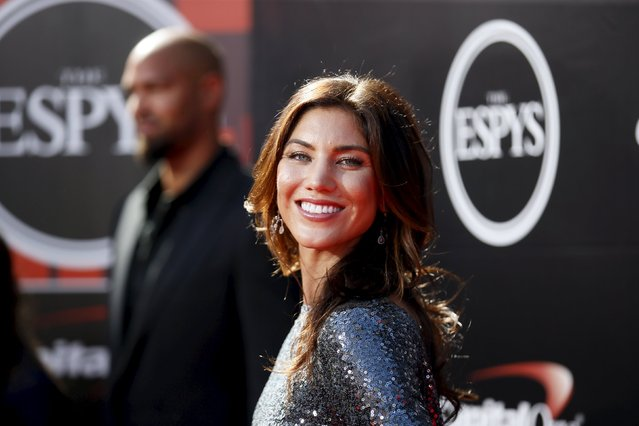 U.S. Women's National Team soccer goalkeeper Hope Solo and former NFL football player Jerramy Stevens (rear R) arrive for the 2015 ESPY Awards in Los Angeles, California July 15, 2015. (Photo by Danny Moloshok/Reuters)