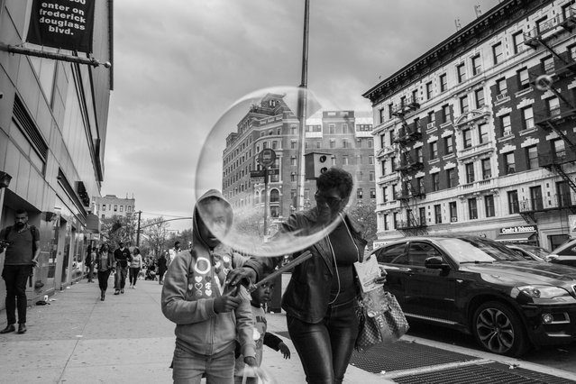 """Bubble"". Shot on the streets of Harlem. Photo location: New York City. (Photo and caption by Amy Sacka/National Geographic Photo Contest)"