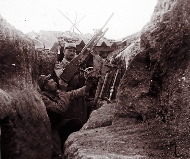 An undated archive picture shows a French soldier aiming an anti-aircraft machine gun from a trench at Perthes les Hurlus, eastern France. (Photo by Collection Odette Carrez/Reuters)