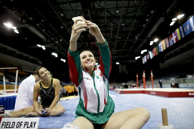 Mexico's Ana Lago, right,  takes a picture with teammate Ahtziel Viridiana, left, during a training session for the Pan Am Games women's artistic gymnastics competition in Toronto, Thursday, July 9, 2015. (Photo by Gregory Bull/AP Photo)
