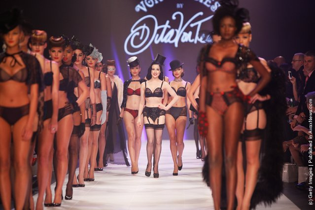 Dita Von Teese and models showcase designs by Von Folies by Dita Von Teese on the runway during L'Oreal Melbourne Fashion Festival