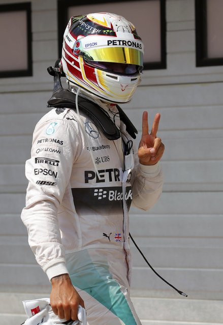 Mercedes Formula One driver Lewis Hamilton of Britain makes victory sign after the qualifying sesson for the Hungarian F1 Grand Prix at the Hungaroring circuit, near Budapest, Hungary July 25, 2015. (Photo by Laszlo Balogh/Reuters)