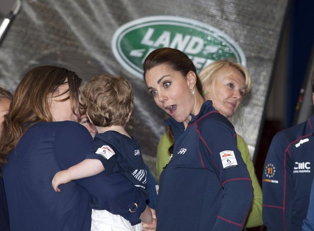 Kate, the Duchess of Cambridge, centre, accompanied by Britain's Prince William,  meets family members  on a visit to the new BAR, Ben Ainslie Racing team base for the America's Cup World Series, in Portsmouth, England, Sunday July 26, 2015. (Photo by Ian Vogler, Pool via AP Photo)