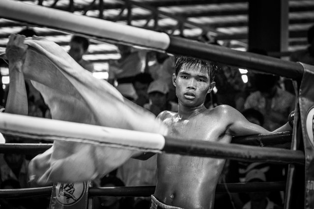 """""""A Khmer Boxer during a break"""". Khmer Boxing is a huge sport in Cambodia. And don't tell a Cambodian that it is just like Thai Boxing – you might get in trouble. Every weekend fights are held somewhere a little bit out of the city center of Phnom Penh. The fights are broadcasted on national television but the entrance is free.The atmosphere with the fighters giving their best and the crowd going crazy is great. Photo location: Phnom Penh, Cambodia. (Photo and caption by Philipp Dukatz/National Geographic Photo Contest)"""