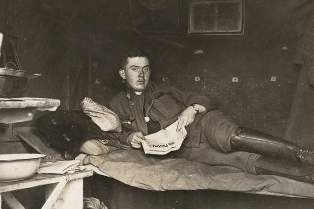 An Austro-Hungarian soldier is pictured in a bunker in an unknown location in this 1916 handout picture. This picture is part of a previously unpublished set of World War One (WWI) images from a private collection. The pictures offer an unusual view of varied and contrasting aspects of the conflict, from high tech artillery to mobile pigeon lofts, and from officers partying in their headquarters to the grim reality of life and death in the trenches. The year 2014 marks the centenary of the start of the war. (Photo by Reuters/Archive of Modern Conflict London)