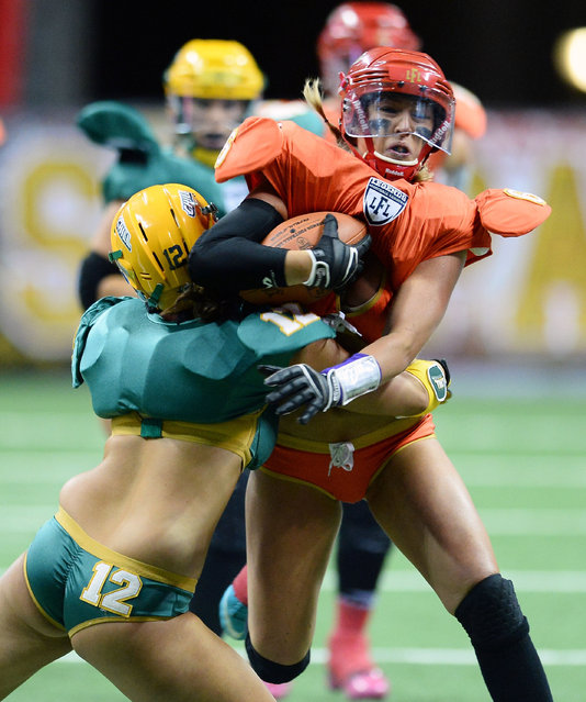 Markie Henderson #6 of the Las Vegas Sin is tackled by Danielle Lucci #12 of the Green Bay Chill during their game at the Thomas & Mack Center on May 15, 2014 in Las Vegas, Nevada. Las Vegas won 34-24. (Photo by Ethan Miller/Getty Images)