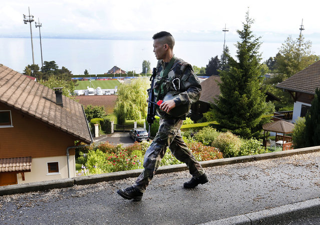 A French army soldier patrols high above the Lake Geneva and the Camille Fournier stadium where the German national soccer team trains in Evian, France, Thursday, June 9, 2016. Germany will face the Ukraine in a Euro 2016 Group C soccer match in Lille on Sunday, June, 12, 2016. (Photo by Michael Probst/AP Photo)