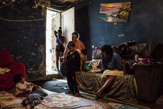 Martha, second from the right, plays with her grandchildren in the 14-storey IBGE building. It is home to about 100 families, after being abandoned in 2000. (Photo by Tariq Zaidi/The Guardian)