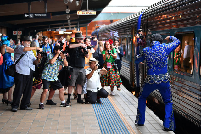 An Elvis impersonator poses for photographs at Central station before boarding a train to The Parkes Elvis Festival, in Sydney on January 9, 2020. (Photo by Dean Lewins/AAP)