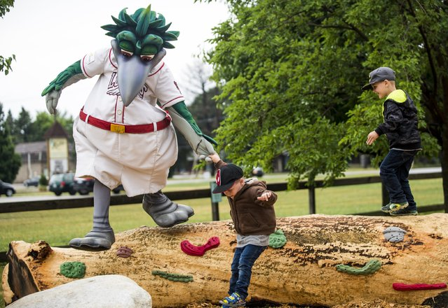 In this June 16, 2016 photo, kids play with Great Lakes Loons mascot Lou E. Loon at the new Discovery Playground inside the Discovery Preserve in Bay City, Mich. (Photo by Jacob Hamilton/The Bay City Times via AP Photo)