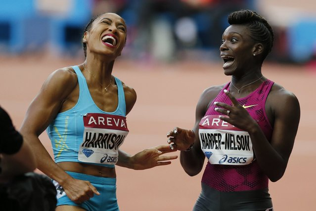 Dawn Harper-Nelson of the U.S. (R) reacts after crossing the finish line, next to compatriot Queen Harrison in the women's 100m hurdles event at the Paris Diamond League meeting at the Stade de France Stadium in Saint-Denis, near Paris, July 5, 2014. (Photo by Gonzalo Fuentes/Reuters)