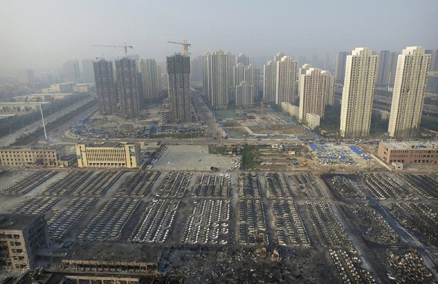 An aerial picture shows damaged cars at the site of Wednesday night's explosions at Binhai new district in Tianjin, China, August 15, 2015. (Photo by Reuters/Stringer)