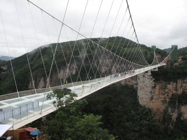 A view of a 430-meter-long glass-bottom bridge before a safety test ceremony, in Zhangjiajie, Hunan province, China, June 25, 2016. (Photo by Jimmy Guan/Reuters)