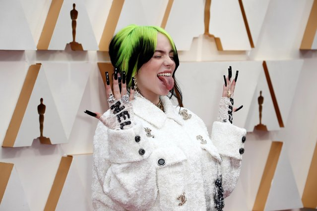 Billie Eilish in Chanel reacts as she poses on the red carpet during the Oscars arrivals at the 92nd Academy Awards in Hollywood, Los Angeles, California, U.S., February 9, 2020. (Photo by Eric Gaillard/Reuters)