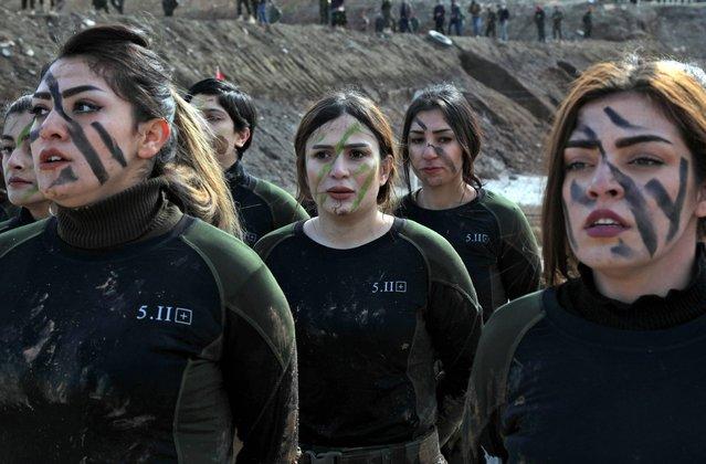 Iraqi Kurdish Peshmerga female officers take part in a graduation ceremony in the Kurdish town of Soran, 100 kilometres northeast of Arbil, the capital of Iraq's autonomous Kurdish region, on February 12, 2020. (Photo by Safin Hamed/AFP Photo)