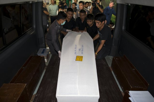 Thai workers carry the coffin containing the body of Malaysian bomb victim Lee Tze Siang at the Institute of Forensic Medicine in Bangkok, Thailand, August 19, 2015. (Photo by Athit Perawongmetha/Reuters)