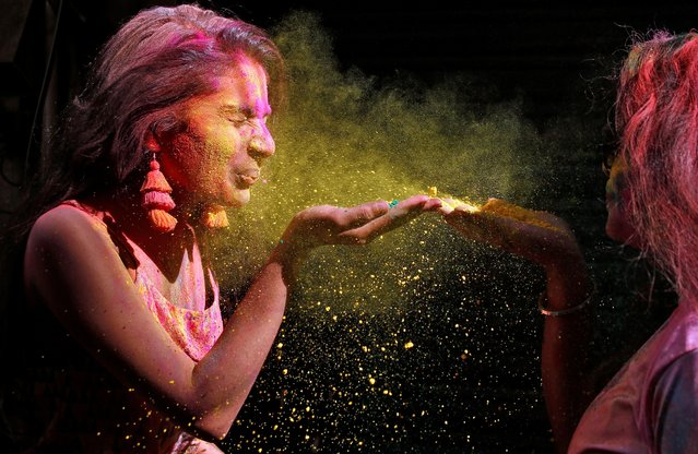 Women blow coloured power during Holi celebrations in Chennai, India, March 10, 2020. (Photo by P. Ravikumar/Reuters)
