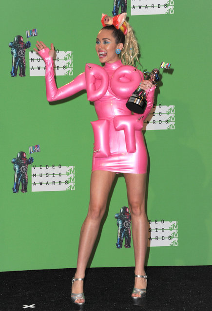 Miley Cyrus poses in the press room at the MTV Video Music Awards at the Microsoft Theater on Sunday, August 30, 2015, in Los Angeles. (Photo by Richard Shotwell/Invision/AP Photo)