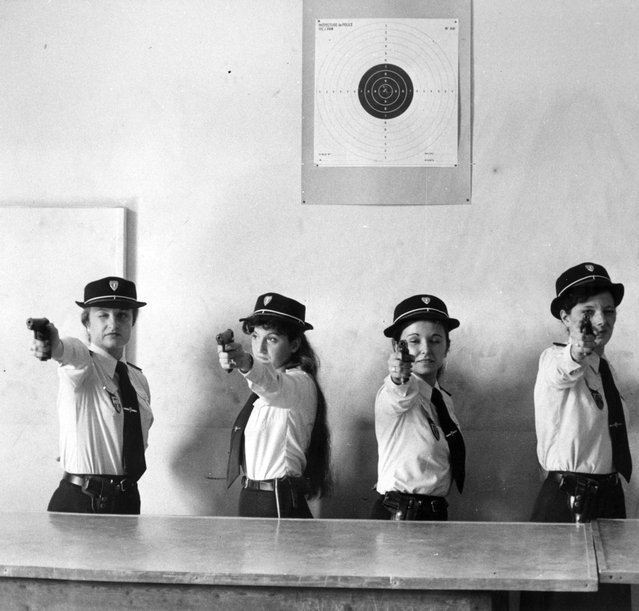 """A line of female police officers take aim during a target practice session. French police auxiliaries from the """"Prefecture de Police de Paris"""", Paris, France, circa 1965. (Photo by Keystone)"""
