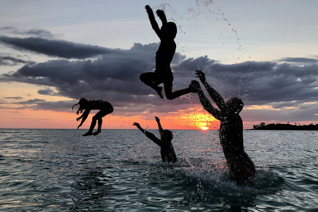 People have fun on a beach during sunset at Ko Kut island in Trat Province, Thailand on October 27, 2018. (Photo by Jorge Silva/Reuters)