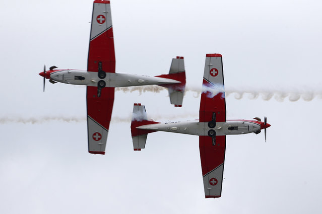 Swiss Air Force PC-7 Team performs during the Air14 airshow at the airport in Payerne August 31, 2014. The Swiss Air Force celebrates their 100th anniversary with the biggest airshow in Europe this year. (Photo by Denis Balibouse/Reuters)
