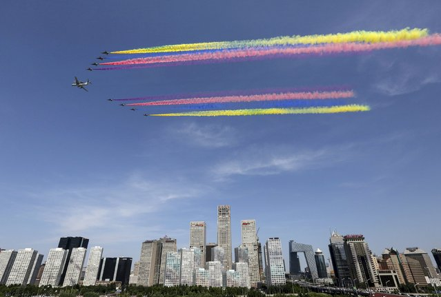 A formation of military airplanes, consists of one KJ-2000 aircraft and eight J-10 fighter jets, flies past the central business area (CBD) of Beijing during the military parade marking the 70th anniversary of the end of World War Two, in Beijing, China, September 3, 2015. (Photo by Reuters/Stringer)