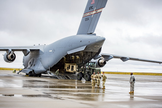Various supplies and military vehicles are loaded into the C-17 Loadmaster as approximately 150 4th Sustainment Brigade, 4th Infantry Division soldiers were deployed to Puerto Rico and the Virgin Islands to provide sustainment support to Hurricane Maria Relief efforts at Fort Carson ADAC/G on Friday September 29, 2017 in Colorado Springs, Colo. (Photo by Dougal Brownlie/The Gazette via AP Photo)