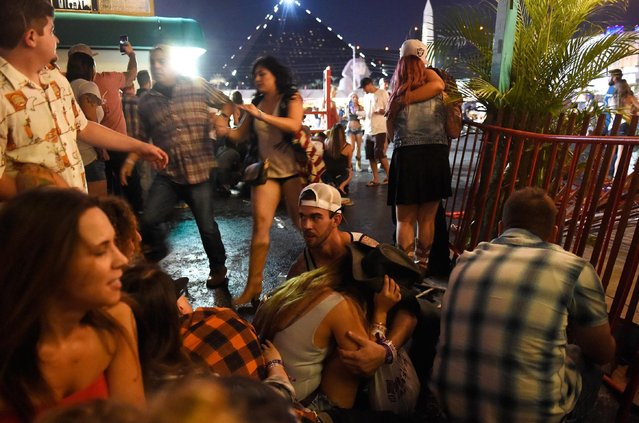 People run for cover at the Route 91 Harvest country music festival after apparent gun fire was heard on October 1, 2017 in Las Vegas, Nevada. There are reports of an active shooter around the Mandalay Bay Resort and Casino. (Photo by David Becker/Getty Images)
