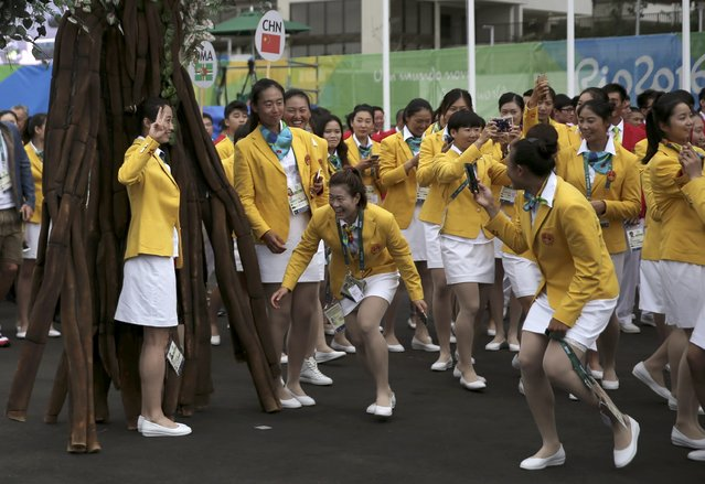 The Chinese team pose for pictures as they arrive at the Olympic Village in Rio de Janeiro, Brazil on August 3, 2016. (Photo by Alkis Konstantinidis/Reuters)