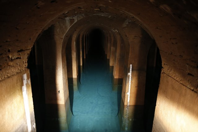 "A general view shows the Reservoir Montsouris, a large supply of drinking water, located in the 14th district of Paris during a press visit, September 9, 2014. Built in the 19th century, the ""cathedral of water"" located in the south of the capital is one of the five largest water reservoirs in Paris and has a capacity of  203,000 m3 of water. It will be open to the public during the 31st European heritage days event ""Journees europeennes du Patrimoine"", on September 20 and 21, 2014. (Photo by Christian Hartmann/Reuters)"