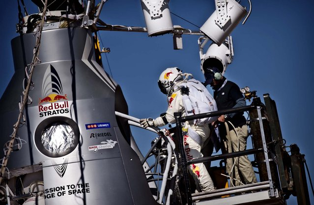 Baumgartner steps into the capsule. (Photo by Balazs Gardi/Red Bull Stratos)