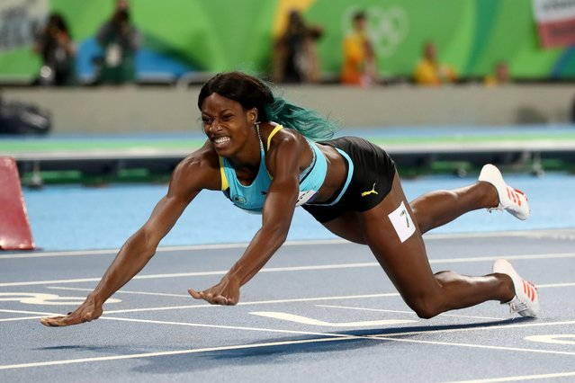 Shaunae Miller of the Bahamas dives over the finish line to win the gold medal in the Women's 400m Final on Day 10 of the Rio 2016 Olympic Games at the Olympic Stadium on August 15, 2016. (Photo by Alexander Hassenstein/Getty Images)
