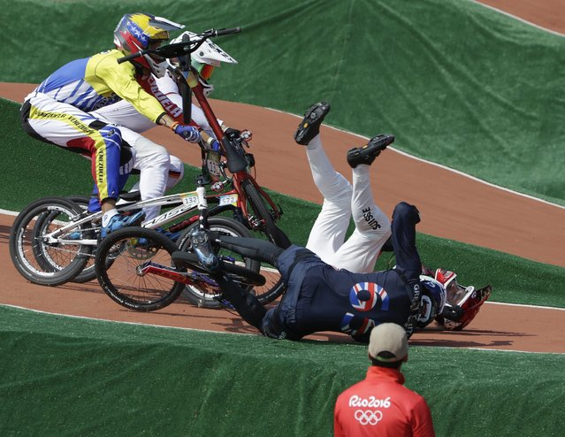 Liam Phillips of Great Britain (Front-R) and David Graf of Switzerland (Back-R)   crash during the men's BMX Cycling quarterfinal competition of the Rio 2016 Olympic Games at the Olympic BMX Centre in Rio de Janeiro, Brazil, 18  August 2016. (Photo by Fazry Ismail/EPA)