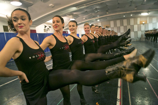 "The Rockettes rehearse their ""New York at Christmas"" number from the 2014 Radio City Christmas Spectacular, in the rehearsal space of St. Paul the Apostle Church, in New York, Tuesday, October 7, 2014. (Photo by Richard Drew/AP Photo)"