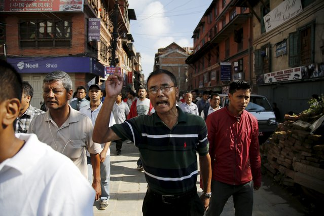 Opposition supporters chanting slogans protest against the proposed constitution during the nationwide strike, called by the opposition parties in Kathmandu, Nepal September 20, 2015. (Photo by Navesh Chitrakar/Reuters)