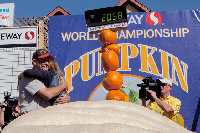 Grower John Hawkley and wife Patty Hawkley celebrate on stage at the 41st Annual Safeway World Championship Pumpkin Weigh-Off  in Half Moon Bay, Calif., Monday, October 13, 2014. (Photo by Alex Washburn/AP Photo)