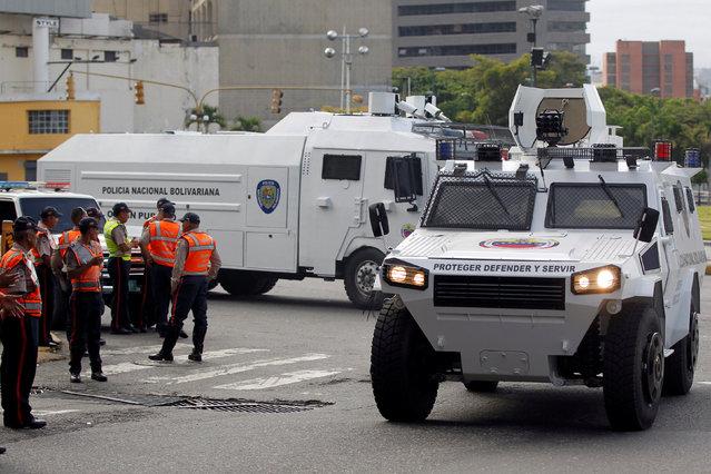 Riot police vehicles patrol during a rally to demand a referendum to remove Venezuela's President Nicolas Maduro in Caracas, Venezuela, September 1, 2016. (Photo by Christian Veron/Reuters)