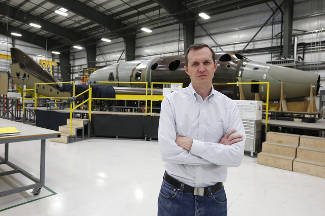 Virgin Galactic's CEO George T. Whitesides stands in front of their new spaceship N202VG, which the company began building 2 and a half years ago, in a hangar at Mojave Air and Space Port in Mojave. (Photo by Lucy Nicholson/Reuters)