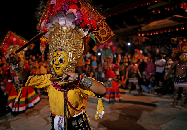 A masked dancer performs a traditional mask dance during the Indra Jatra festival in Kathmandu, Nepal September 13, 2016. (Photo by Navesh Chitrakar/Reuters)