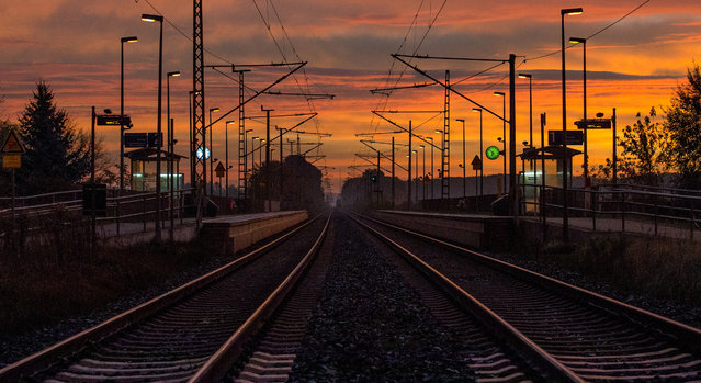 Dawn at the train station in Jacobsdorf, Germany, November 5, 2014. Deutsche Bahn will begin the longest strike in its 20 year history, striking for more than four days. (Photo by Patrick Pleul/EPA)