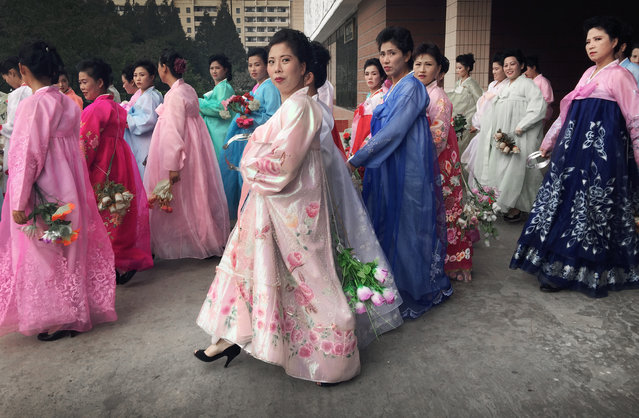 North Korean women wearing traditional dresses gather for rehearsals, Wednesday, October 7, 2015, in Pyongyang, North Korea in preparation for the 70th anniversary of the founding of their country's ruling party on Oct. 10, 2015. (Photo by Wong Maye-E/AP Photo)