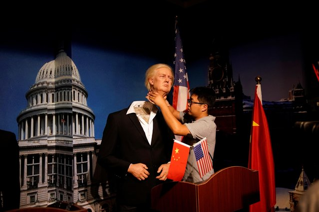 A technician demonstrates for the camera the assembling of a wax figure of President Trump at a wax museum of Shanghai Maiyi Arts in Shanghai, China on August 21, 2020. Shanghay Maiyi Arts was founded in 2012 as a manufacturer and supplier of wax figures. Located in the outskirts of Shanghai, about an hour's drive from the city centre, its exhibition hall also doubles as makeshift museum, where guests can pose next to replicas of North Korean leader Kim Jong-Un, martial arts star Jackie Chan, and others. Zeng says that by 2019, the company was shipping up to 700 figures annually to customers, with about one-third going overseas. (Photo by Aly Song/Reuters)