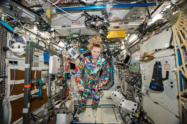 This undated handout photo from NASA shows astronaut Kate Rubins aboard the International Space Station wearing a hand-painted spacesuit decorated by childhood cancer patients at the University of Texas MD Anderson Cancer Center in Houston. NASA said Rubins will chat from the space station with patients during a 20-minute call on Friday, September 16, 2016. (Photo by NASA via AP Photo)